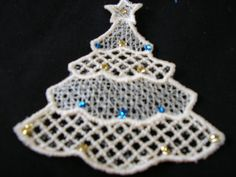 Christmas Tree Ornament Lace - Tree in Beige with Blue & Gold Glitter & a Blue Ribbon for Hanging.  Nice add on to decorate a package.
