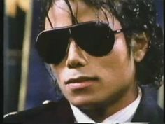 ♡♥Michael Jackson goes from a serious looking secret agent look to a relaxing smile look GIF pic - click on GIF pic to see a full screen GIF pic in a better looking black background♥♡