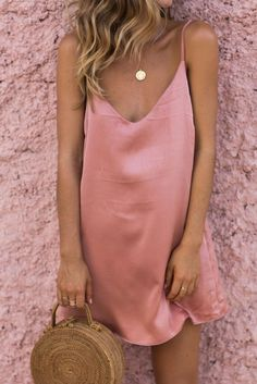 pink silk slip dress and woven bag for spring