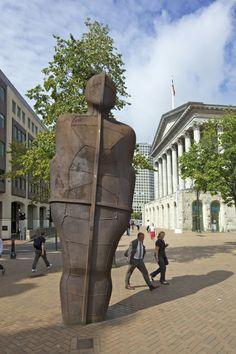 Pedestrians pass the Iron Man sculpture by Antony Gormley 1993 (Peter Barritt/Robert Harding /AP Images)
