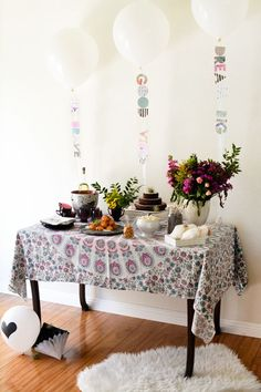 Throw a good vibes themed baby shower. This boho shower works for boys or girls and is perfect with fresh flowers, air plants and a cool tapestry tablecloth.