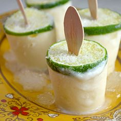 Creamy Margarita Popsicles Ingredients cup fresh lime juice (about 8 limes), plus 4 limes for stabilizing the popsicle sticks 1 can of sweetened condensed milk 1 cup water ¼ cup tequila 2 tablespoons orange juice (optional) Kosher salt or margarita salt Summer Drinks, Fun Drinks, Beverages, Easy Cocktails, Mixed Drinks, Bebidas Com Rum, Yummy Treats, Yummy Food, Delicious Fruit