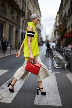 loewe puzzle leather shoulder bag in red; cropped flared pants in beige; Wish list and beautiful styles from OutfitGoals for designer shoes, bags, and cloth! New Today, Flare Pants, Leather Shoulder Bag, Designer Shoes, Street Style, In This Moment, Eyes, Chic, Instagram Posts