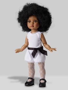 Effanbee 2014 10 inch hard plastic and vinyl Trixie Basic Doll (dark skin version of Patsy) has a non-removable curly raven black wig hazel inset eyes with applied lashes, honey skin-tone, and a bend knee child's body the same size similar to the later Ann Estelle dolls.This is the later body with bending elbows and wrists. This is an African-American or dark skin version of Patsy. She is wearing a white stretch knit onesie with black ribbon belt and lace trim, white stretch lace tights…