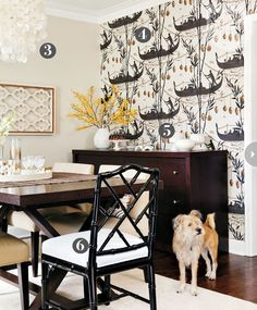 Fun wall papered accent wall in a dining room...