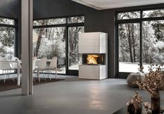 Visio 3 is a concrete element that you can integrate in you home and use for your fireplace insert. These very simple and light concrete blocks frame the Visio 3 insert beautifully. Fireplace Inserts, Modern Fireplace, Concrete Blocks, Minimalism, Living Room, Simple, Design, Furniture, Divider