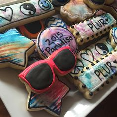 The end result of the crazy water colored cookies! These are off to Paradiso this weekend! #SugarCoatedDesserts #paradiso #plur #watercolor #decoratedcookies #cookieart #sugarcookies #editableart #sunglasses #peace #love #respect #unity