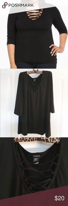 Torrid Deep V Lace Up Top Torrid Deep V Lace up top has 3/4 sleeves and Deep V neckline with Lace up detail. Stretchy knit material, but runs a little small. Tag says 4, but fits like a 3! Excellent condition! torrid Tops Tees - Long Sleeve