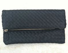 black woven leather foldover clutch with detachable wrist strap