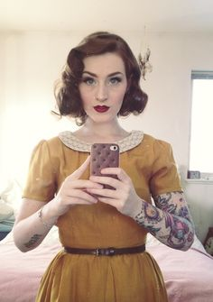 Nice mustard dress with peter pan collar and light belt. The brown curly hair gives match perfectly with that retro look.