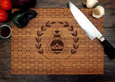 Honey Bee Cutting Board Pictured in Amber approx. 12 x by WoodKRFT, $44.00