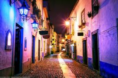 Blue Lamps, Obidos, Portugal by Joe Daniel Price on Alleyway, Southern Europe, Street Photo, Around The Worlds, Skyline, Blue Lamps, Travel Plan, Backstage, Ballerina