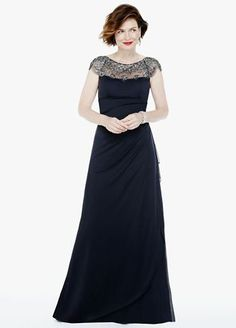 Add a little vintage glamour to your wardrobe with this stunning cap sleeve beaded dress!  Cap sleeve bodice features heavily beaded illusion neckline.  Long sheer matte jersey dress with figure flattering side ruffle.  Fully lined. Back zip. Imported polyester. Professional spot clean. Available in Plus sizes as Style XS5733W.