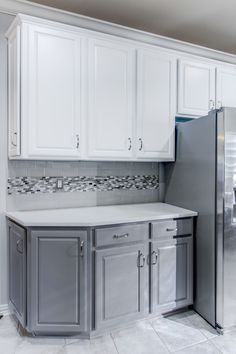 kitchen cabinets grey bottom white top we brought this kitchen up to date by painting the 20462