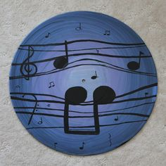 For the music lover, a vinyl record featuring a purple fantasia. Painted on a 12 LP.
