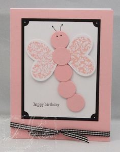 Adorable butterfly created with circle and heart punches! Assembled here in pink and white, with black/white accents, they make a fun handmade birthday card.