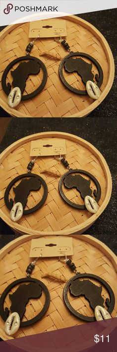 Black wood map of Africa with mounted sheels Black map of Africa with bottom mounted cowrie shells earrings . 2 1/2 inches in length light weight. Jewelry Earrings