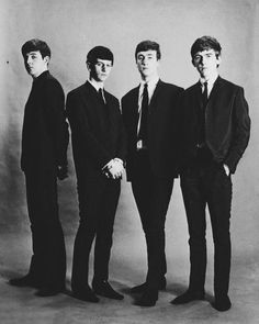 The Beatles in their black suits circa 1964.