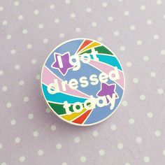 From our Adult Achievement Stickers, this hard enamel pin badge features the I got dressed today design - celebrate small victories and reward