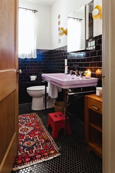 lilac sink, black subway + penny tile