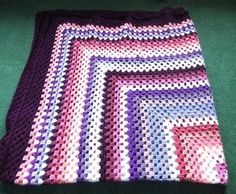 This beautiful Granny style blanket is handmade by myself.  It has been made using a range of shades of white through to pink to burgundy to  purple  I have then added a border too that just finishes it off nicely. It measures 72 inches by  66 inchesv ...
