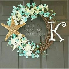This wreath is perfect for any beach home or beach themed home!  Wreath measures 18 - 20 inches in diameter at its widest. The first picture