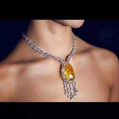 repost from @formsjewellery Natural Golden Orange Sapphire & Diamond Necklace - Forms Jewellery