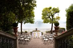 beautiful gardens of Villa Cipressi looking out with the amazing view of Lake Como