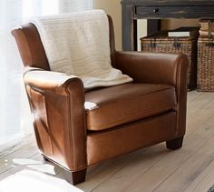 Irving Leather Armchair | Pottery Barn. Comfortable,  simple tgough a little boring