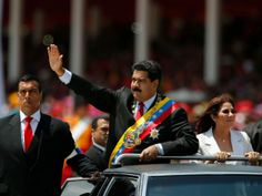 Venezuela's President Nicolas Maduro, centre, and his wife, Cilia Flores, arrive in a limousine for a military parade
