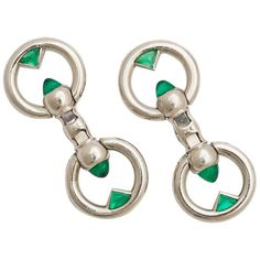 Art Deco Cartier Emerald Platinum Cufflinks. Pair of platinum stirrup double cufflinks, each link set with two sugar loaf cabochon emeralds, and two fancy triangular-cut emeralds. In Cartier box.  By Cartier, Paris. Circa 1928