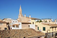 Palace in Palma Old Town with roof terraces and vaulted cellars.