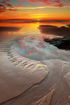 Pathway to the sun. Tasmania, Australia!!! Bebe'!!! Reflections of pink clouds in a tidal pool!!!