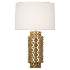 Whether or not you associate with the well-known, at least have the taste of the rich and famous with this gorgeous collection of lamps. Comes in 3 finishes. Specifications: - FINISHES: Gold Metallic