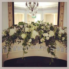 Cascading fireplace arrangement bt Hayford & Rhodes | Flowers ...
