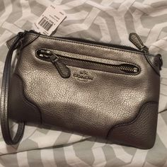 cute Coach Clutch Metallic Silver Coach clutch. New with tags. Never used! Coach Bags Clutches & Wristlets