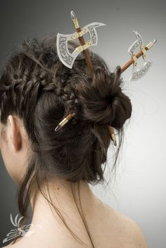 Battle ax hair pins. HOLY CRAP. totally multi-functional. Use them to hold your hair up and hack people when you're threatened! ....huh? no one else ever wants to hack people with battle axes? .....