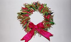 Tie on pieces of ribbon, material or anything else you have to hand (I've seen a lovely orange wreath made from pieces of Sainsburys bags). Description from theguardian.com. I searched for this on bing.com/images