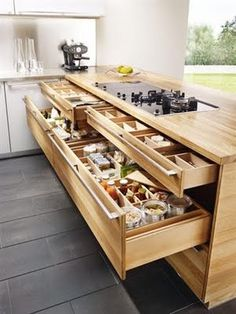 Good use of drawer space. I love deep drawers with adjustable compartments or dividers. There was another wide, shallow drawer that had diagonal dividers to organize long spatulas, spoons, and other kitchen utensils.