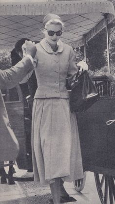 """Princess Grace in 1956, carrying the style of handbag that became known as a """"Kelly Bag."""""""