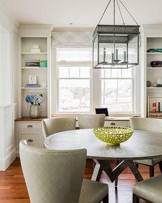 Breakfast Nook. Kitchen Breakfast Nook Ideas. Transitional breakfast nook with square gray lantern pendant and cabinets framing window. #BreakfastNook #Kitchen Jennifer Palumbo.