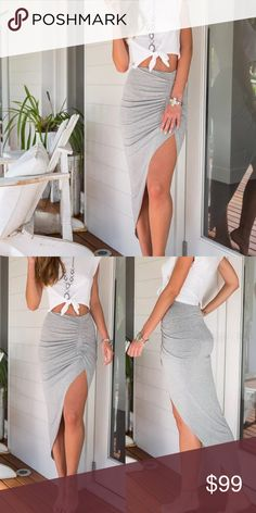 Coming soon grey asymmetrical skirt Coming soon gray asymmetrical skirt with ruched detail. Price will change when item becomes available for purchase. boutique Skirts Asymmetrical