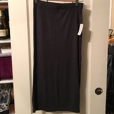NWT Forever 21 Charcoal Jersey Midi Skirt - Sz M Charcoal gray jersey midi skirt by Forever 21. Has left side slit. Never worn. Original tags attached. Very good condition. Forever 21 Skirts Midi
