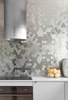 Interesting patterned stainless steel backsplash