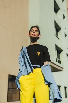 Lately I've been really into graphic t-shirts. If there's a way to tell someone how you're feeling or what you're thinking, it's with graphic tees. Not to mention, they're comfortable and easy to throw on in the morning. The styling possibilities are just endless. #graphictees #tshirteditorial #yellowpants #streetfashioneditorial