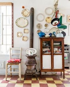 This house once had plants growing out of holes in the floor. After a brave restoration, it's now a country chic home full of colorful collections.