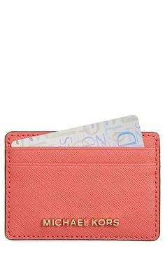 In love with this Michael Kors card holder in pink grapefruit and gold details.