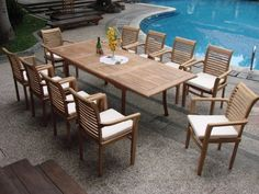 """New 11 Pc Luxurious Grade-A Teak Dining Set - Large 117"""" Rectangle Table And 10 Stacking Arm Chairs [Model:MS5] by WholesaleTeak. $1759.99. You can lengthen the table with minimal effort by simply opening the butterfly leaf extensions.. Chair Dimension: 24 1/2"""" Width x 19"""" Depth x 37 1/2"""" Height. Rectangle Table Dimension: 82"""" L(without extension) and 117"""" L(with extension), 42.5"""" W , 30.5"""" H. ADD SUNBRELLA FABRIC CUSHIONS BY SEARCHING """"Wholesaleteak Dining Cushion"""" ON AMAZON,..."""