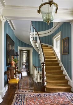 Striped wallpaper and curving staircase