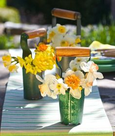 Daffodil spring centerpiece: Bulb planters are handy for getting daffodils into the ground in fall, and they double as quaint containers in spring.  More spring centerpieces: http://www.midwestliving.com/homes/seasonal-decorating/50-bright-and-easy-spring-decorating-ideas/?page=7